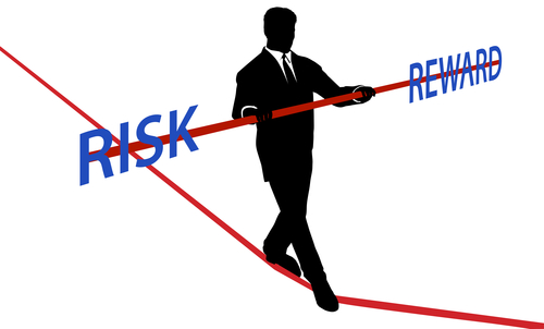 Business man tightrope balance RISK REWARD